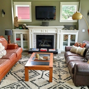 In Sara Dahlquist's new living room, two large leather couches are perfect for Game Night.